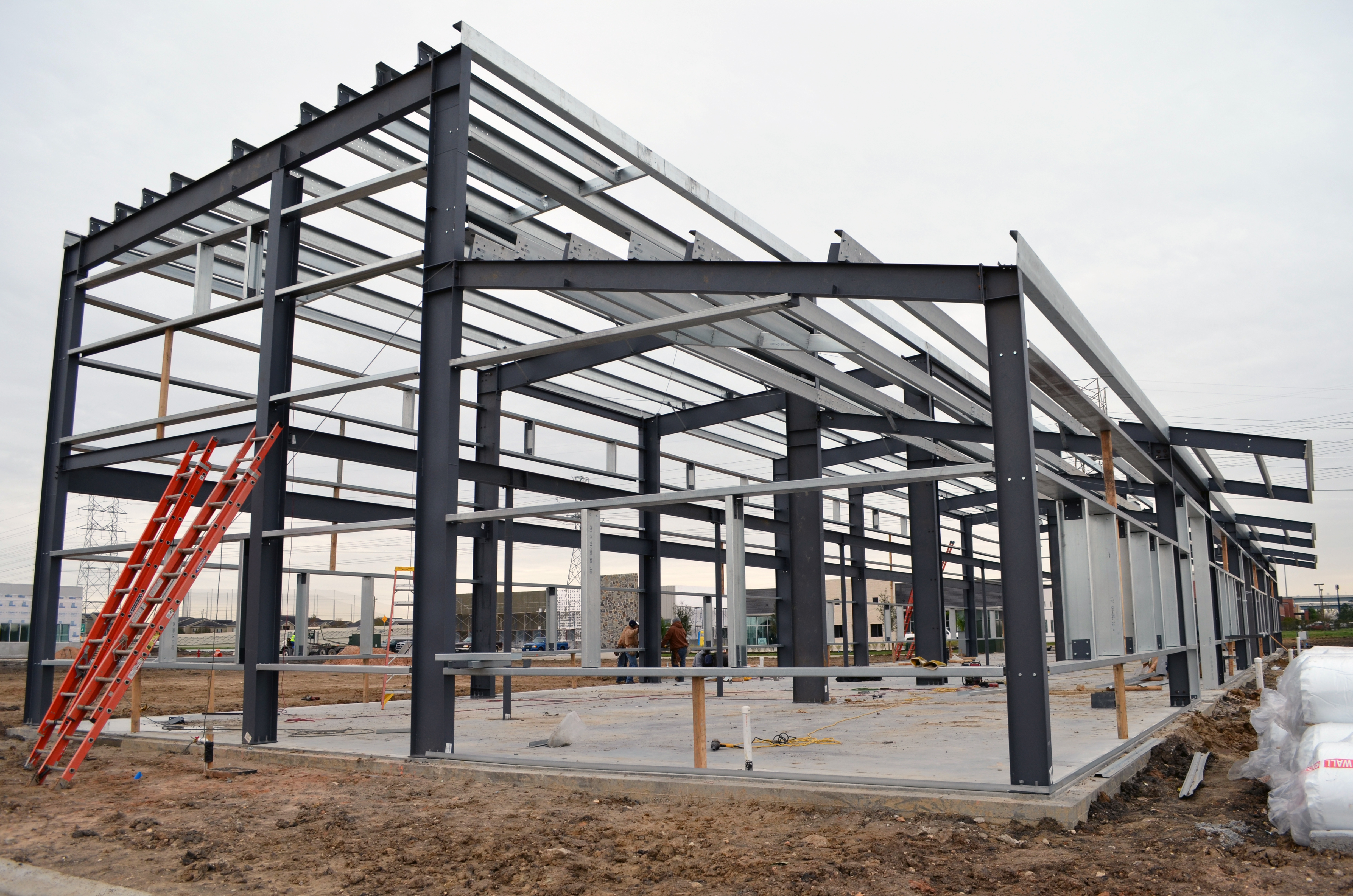 Structural Steel Framing : The foundation is poured and steel structure up